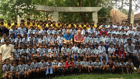 Group shot of Indian (Bangalore) school students and James