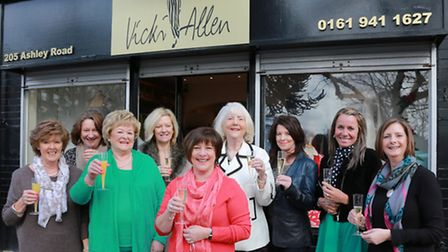 Vicki Allen (centre) celebrates 23 years in fashion at Hale village with staff and friends