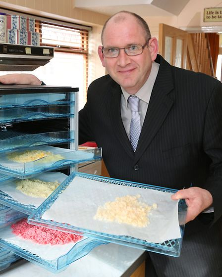 Chris O'Byrne with his sugar drying cabinet