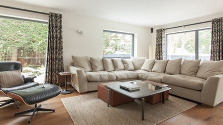 The sofa and Eames chair in the sitting room are from Heals and the footstools from Footstool Compan