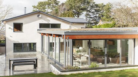 The rear of the house has been completely transformed and enormous floor-to-ceiling sliding glazed p