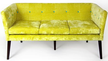 This quirky three-seater sofa has contrasting buttons and can be upholstered in a designer fabric of