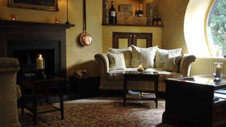 The comfortable sitting area by the bar, complete with log burner