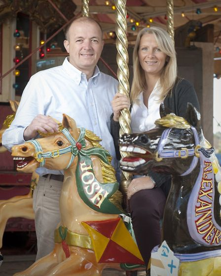 Chris and Katie Down on Crealy's carousel