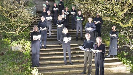 Some members of the Dartington Community Choir in the grounds of Dartington Hall.