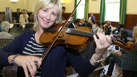 Jan Modelski's Community Youth Orchestra in rehearsals at Barrow Village Hall; Mags Kerns on violin