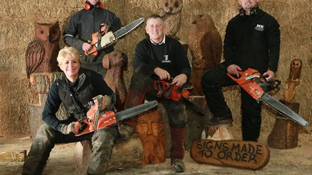 The Burgess family; Michele and Tim (seated) with Andy (left) and Mike at their barn in Mobberley