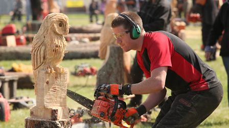 Andy Burgess from Didsbury taking part in the Chainsaw Speed Carving competition..