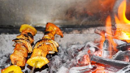 Pork pinchitos (two pork skewers marinated in a blend of Moorish spices with mushroom, onion and pep