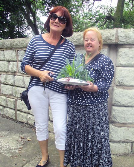 """Elaine Hargreaves and her entry for the """"Garden on a Plate"""" competition with her support worker, Pat"""