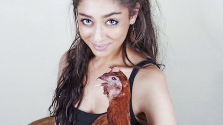 Elle Kaye with a chicken she has 'brought back to life'