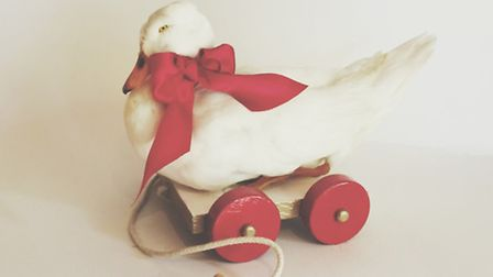 Duck re-imagined as a child's pull-along toy