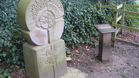 Memorial to Forster next to a plaque commemorating Poston at St Nicholas Church, Stevenage. Image JS