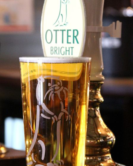 Otter Brewery pint glass and tap