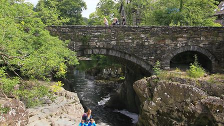 Dot Hansen and her boys, Kare (11) and Trygg (9) by the river Conwy beneath Pont-y-Pair (the bridge