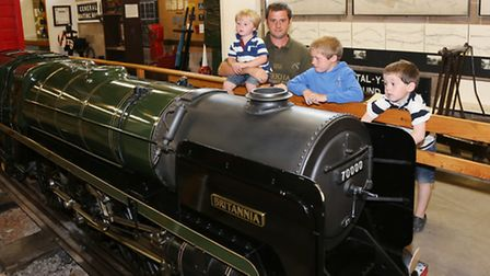 William Dudill and boys, William (3), Charlie (8) and Harry (5) with an exact quarter-scale replica