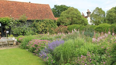 Wide borders filled with naturalistic planting at The Barn garden