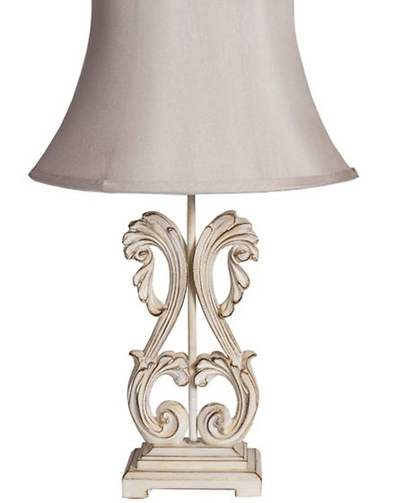 This delicate lamp has an exquisite decorative base finished with aged cream and a fluted satin shad