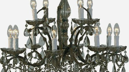 A sublime 12-arm chandelier, made from a pewter frame adorned with smoked crystal beads, then draped