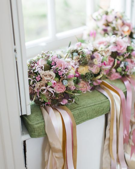 Pale coloured ribbons make an elegant addition to these bouquets