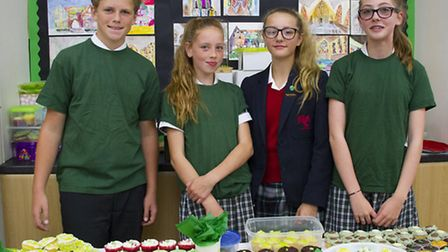 Hurst Prep pupils sell cakes for Macmillan Coffee Morning