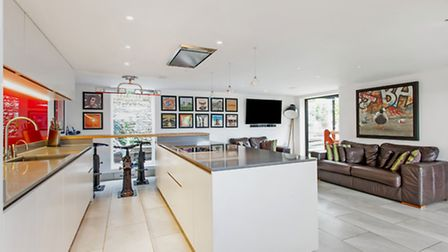 The open plan kitchen and breakfast room has a rock chic vibe with bar stools from vintage lorries a