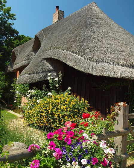 The walk passes a picturesque thatched cottage between Point 3 and 4