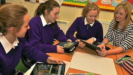 NORTH. STORY REPORTERS. Students at Ellesmere College using technology in the classroom. Three stude