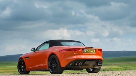 Twin exhausts and wide lights give the rear a fiercesome look