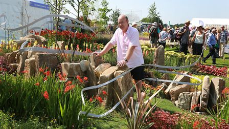 Michael Vinsun of Congleton in his 'Element Garden' inspired by the four elements of earth, wind, fi