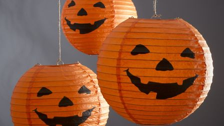 Pumpkin Pretty This set of three Halloween Paper Lanterns can be hung by front door or window as a