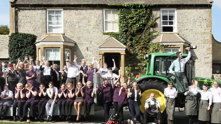 The Dormy House team celebrate at the front of the hotel