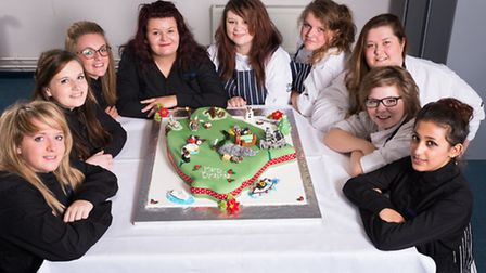Exeter College students with the cake. Picture: Ian Jackson