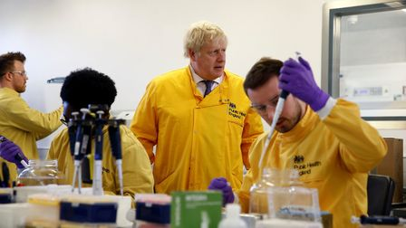 Prime Minister Boris Johnson visits a laboratory at the Public Health England National Infection Ser