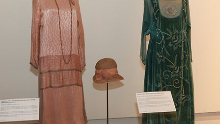 (L-R) Silk crepe day dress with straw hat worn by Lady Mary Crawley (Cosprop for Downton Abbey, 2011