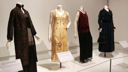 (From the LNM archive L-R) Evening dress of silk georgette and silk satin with bodice trimmed with g