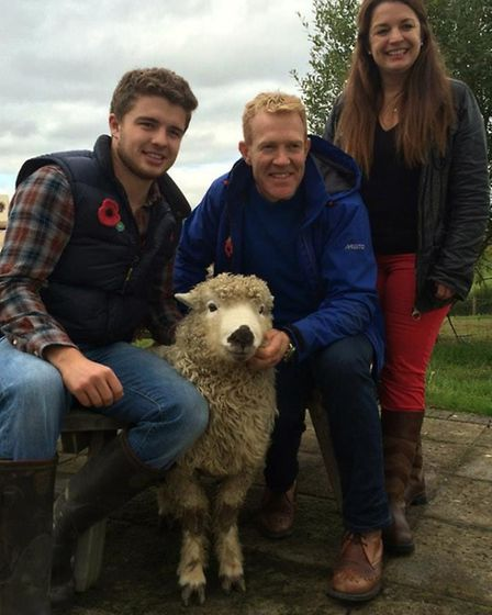Lewis Steer with his mother and Adam Henson