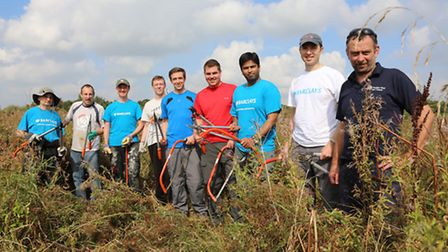 Northwich Woodland Ranger, Dave Jones (right) with the Barclays Bank 'Making a Difference Day' parti