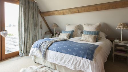 All the bedding is from The White Company, and the bedside tables were painted by Sally in 'Slate 5'