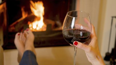 Drinking wine in front of fire.