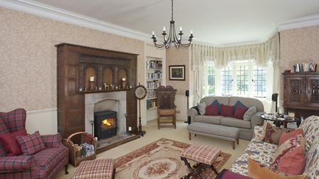 The sitting room or 'snug' has a different feel as it is decorated with rich reds