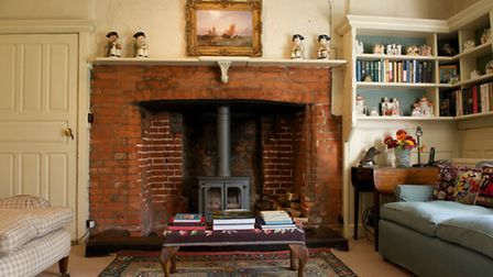 Sitting room with its fireplace, thought to be original to the house (built in 1550)