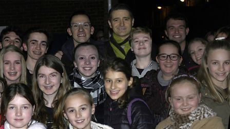 Tom Chambers (centre) and Matthew Cheney (left, centre) with GAPA pupils at the Dominion Theatre Sta