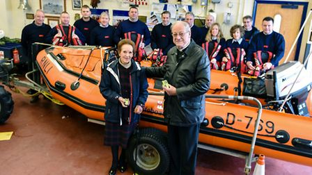 Susan Cheney MBE with Rev David Farrant with members of the volunteer lifeboat crew following the de