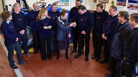 Susan Cheney MBE presenting the PLBs to members of the volunteer lifeboat crew. Ritchie Souhterton/R