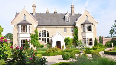 The house has elements of country manor and gothic mansion