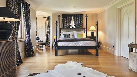 The master bedroom with gothic style bed