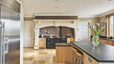 The fireplace in the kitchen was built to house the Aga