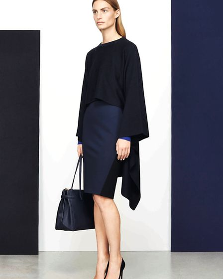 Layer up for winter in this cape sweater £250, skirt, £150 and Gostwyck cuff sweater, £99. Maddison