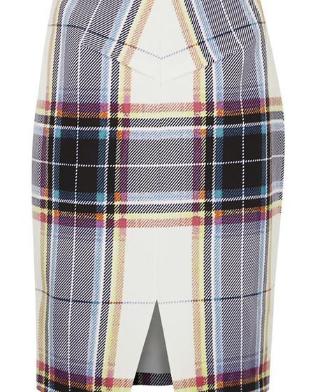 Wear this Finders Keepers plaid skirt with a turtle neck for work and layer over a sheepskin gilet f